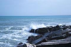 Black Rock Natural Formation Front of Sea Stock Photos