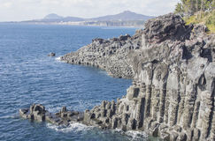 Black rock nature cliff in volcano island with ocean Royalty Free Stock Image