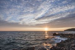 Black Rock Beside the Sea Under the Sunset stock photography