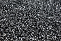 Black Rocks on the Beach Royalty Free Stock Photography
