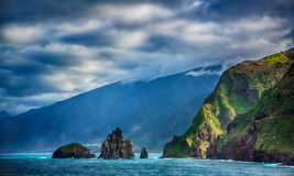 Black rocks in the ocean and coastline of Madeira island Royalty Free Stock Images