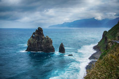 Black rocks in the ocean and coastline of Madeira island Stock Image