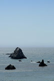 Black rocks in the pacific ocean Royalty Free Stock Photography
