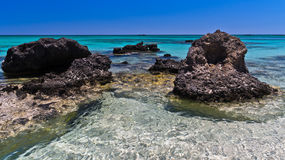 Black rocks and turquoise water at Elafonissi beach, island of Crete royalty free stock image