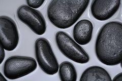 Black Rocks in Water Stock Image