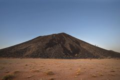 Black rocky mountain. In arid country Namibia stock photography