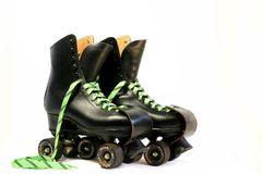 Black rollerskates royalty free stock photography
