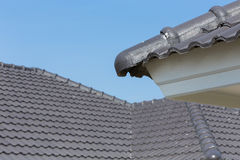 Black roof tiles on house Stock Images