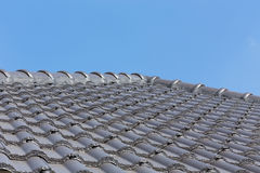 Black roof tiles on house Stock Image