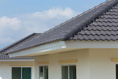 Black roof tiles on house Royalty Free Stock Photos
