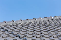 Black roof tiles on house Stock Photos