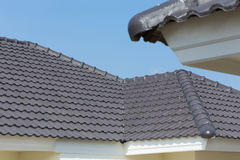 Black roof tiles on house Royalty Free Stock Image