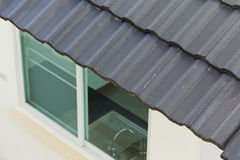 Black roof tiles on house. Black roof tiles on new house Stock Images