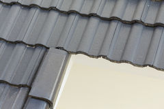Black roof tiles on house Stock Photography