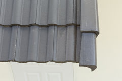 Black roof tiles on house. Black roof tiles on new house Royalty Free Stock Photography