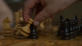 Black rook capturing white pawn in chess game stock video footage