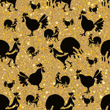 Black Roosters on a golden. Stock Photography