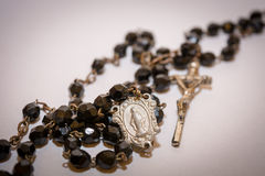 Black rosary on the white background Royalty Free Stock Image