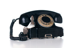 Black rotary phone. Old vintage black rotary phone, isolated on white background Royalty Free Stock Photos