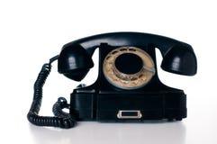 Black rotary phone. Old vintage black rotary phone, isolated on white background Stock Image