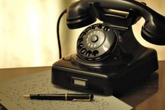 Black Rotary Telephone Beside Ball Pen on White Printed Paper Stock Images