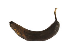 Black rotten banana isolated. Over white background Royalty Free Stock Photos