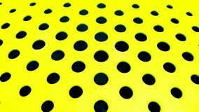 Black round holes on a flat yellow surface go ahead as the background royalty free stock images