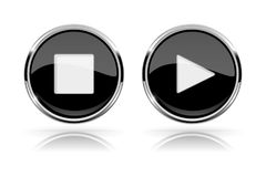 Black round media buttons. PLAY and STOP buttons. Shiny icon with chrome frame and with reflection. Vector 3d illustration on white background Royalty Free Stock Images