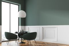Black round table in a cafe corner. Black round table standing in a cafe corner with green chairs near it and a panoramic window in the background. 3d rendering Royalty Free Stock Images