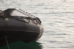 Black rubber boat in Montenegro sea royalty free stock images