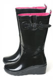Black rubber boots. On white background with pink insides Stock Image