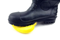 Black rubber boots with banana Stock Images