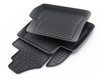 Black rubber car mats isolated on white background. 3D illustration Stock Images