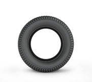Black rubber car tire. On a white background Royalty Free Stock Photos