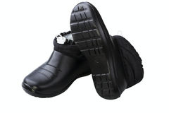 Black rubber female shoes Stock Images