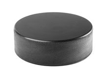 Black rubber hockey puck Stock Image
