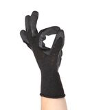 Black rubber protective glove shows sign ok Royalty Free Stock Photography