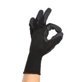 Black rubber protective glove shows sign ok. Royalty Free Stock Image