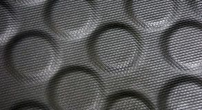 Black rubber bumps texture. Black rubber texture background, piece of textured rubber with many circular bumps, tiny rhomboidal over the surface of this rubber royalty free stock images