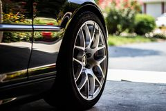 Black Rubber Tire on Gray Asphalt Road Stock Photography