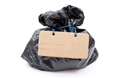 Black rubbish bag with lace and tag Royalty Free Stock Photography