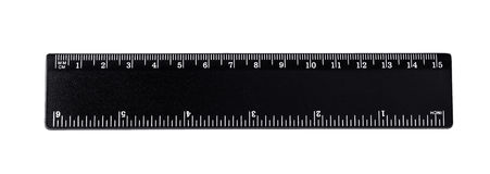 Black ruler isolated, inches, centimeters. Millimeters, imperial and metric distance length units, cm and mm marks, detailed macro closeup, white numbers on royalty free stock photo