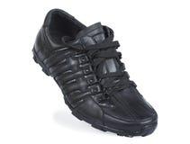 Black running shoe on the white Stock Photos