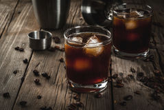 Black Russian cocktail with vodka and coffee liquor. Alcohol. Drinks, Boozy Black Russian cocktail with vodka and coffee liquor on rustic wooden table. copy Stock Image