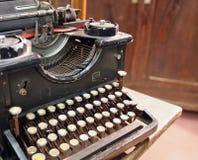 Black rusty typewriter with round keys Royalty Free Stock Photo