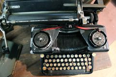 Black rusty typewriter used by typists than once Royalty Free Stock Photos