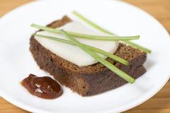 Black rye bread with lard Royalty Free Stock Image