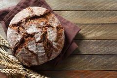 Black rye bread on a napkin Stock Photos