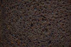 Black rye yeast bread, piece, texture of dough royalty free stock photo