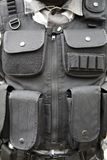 Black S.W.A.T vest. Part of soldier's equipment Royalty Free Stock Images